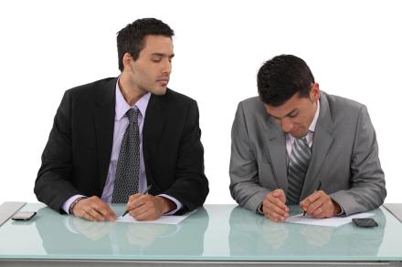 bigstock-Businessman-cheating-in-exam-43995148