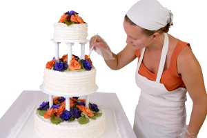 Final Touch Ups On Ruffled Wedding Cake