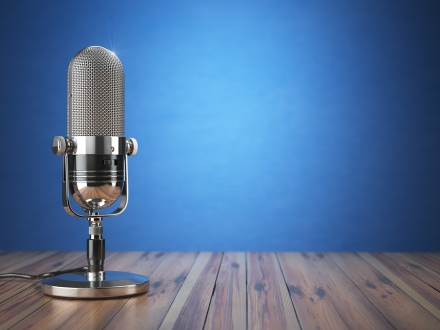 Retro old microphone. Radio show or audio podcast concept. Vinta